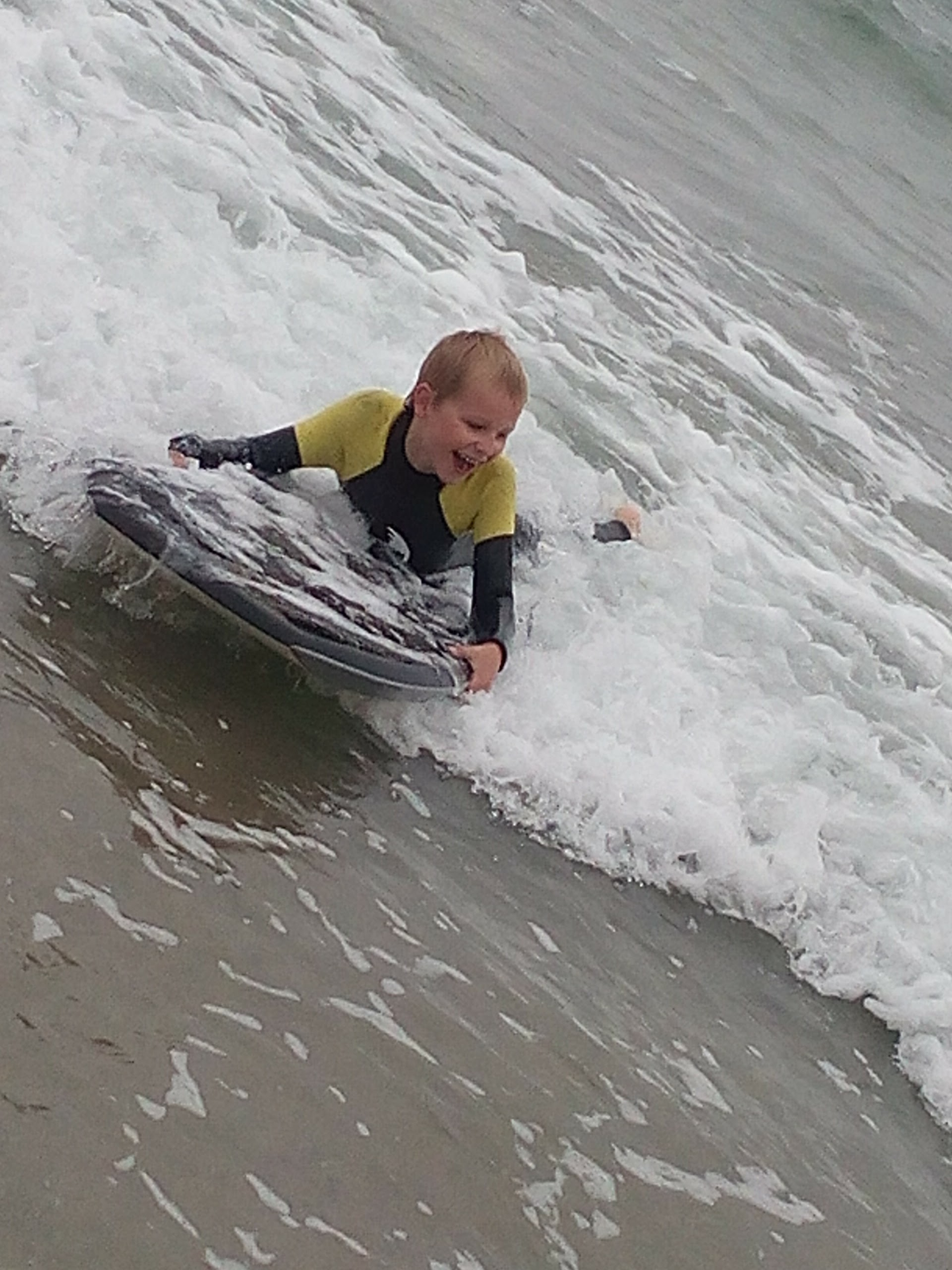 body boarding fun in Cornwall in our kids winter wetsuit. Full 5mm super stretch neoprene with GBS seams