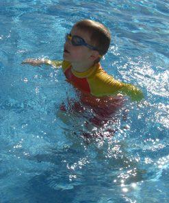 Kids long sleeve UV50+ rash vest at use in the swimming pool