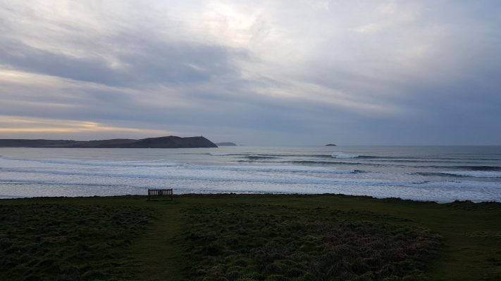 Surf rolls in at new Polzeath, North Cornwall
