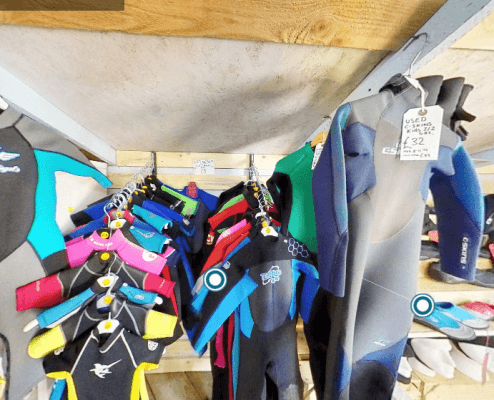 many pre-loved and used wetsuits